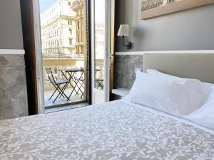 Łóżko lub łóżka w pokoju w obiekcie Piazza Bovio 22