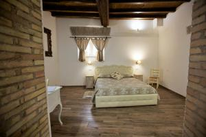 A bed or beds in a room at Navona Sweet Home