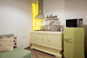 A kitchen or kitchenette at Navona Sweet Home