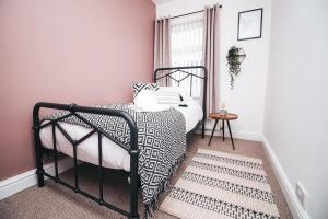 A bed or beds in a room at Commercial House, By Solace Stays