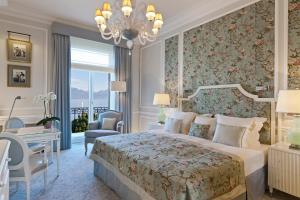 A bed or beds in a room at Beau-Rivage Palace