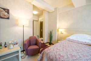 A bed or beds in a room at Ioana Hotel