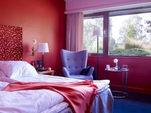 En eller flere senger på et rom på Thorbjørnrud Hotel