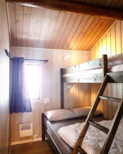 A bunk bed or bunk beds in a room at Groven Camping & Hyttegrend