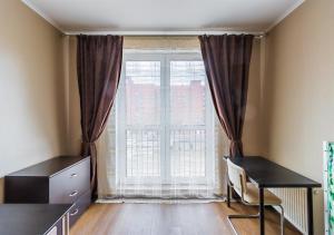 Телевизор и/или развлекательный центр в Апартаменты в новом доме на Кременчугской 13