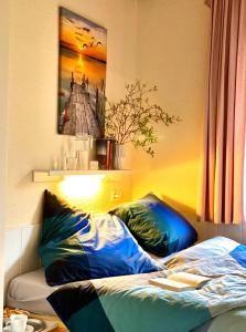 Ein Bett oder Betten in einem Zimmer der Unterkunft Ferienhäuser Pannier III und IV Doppelhaushälften
