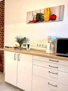 Küche/Küchenzeile in der Unterkunft Ferienhäuser Pannier III und IV Doppelhaushälften