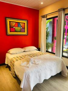 A bed or beds in a room at Millenium Manuel Antonio