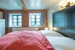 Ein Bett oder Betten in einem Zimmer der Unterkunft Schmucke Stuuv