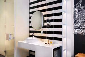 A bathroom at ibis Styles Dubai Airport Hotel