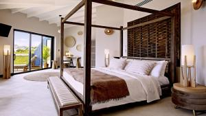 A bed or beds in a room at Tamarind Hills