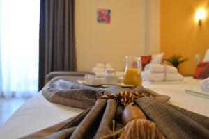 Ένα ή περισσότερα κρεβάτια σε δωμάτιο στο VILA ELVINA