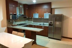 A kitchen or kitchenette at Penthouse frente al mar - Playa Señoritas