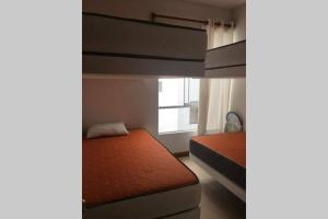 A bed or beds in a room at Penthouse frente al mar - Playa Señoritas