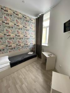 Телевизор и/или развлекательный центр в Art-Hotel Centralnyi