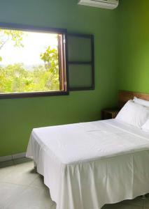 Cama o camas de una habitación en Pousada Arraial Das Cores