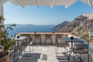 A balcony or terrace at Porto Fira Suites