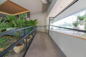 A balcony or terrace at Coral Trade - Hospitais Puc RS e Clínicas - Pet Friendly