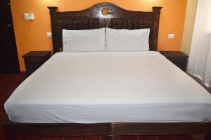 Cama o camas de una habitación en Hotel Casa Rico