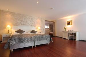سرير أو أسرّة في غرفة في فندق ألفا سولي
