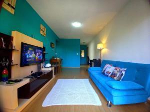 A seating area at Apartamento Completo no Centro São Leopoldo com Sacada Net Wi-Fi