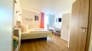 Ein Bett oder Betten in einem Zimmer der Unterkunft i-Motel