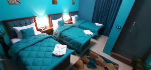 Cama o camas de una habitación en Cairo Plaza Hotel