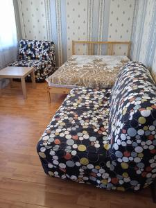 A bed or beds in a room at Apartment on Levchenko 8