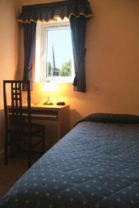 A bed or beds in a room at Gatwick House