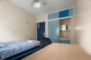 A bed or beds in a room at LSE Carr-Saunders Hall