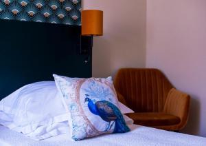 Un ou plusieurs lits dans un hébergement de l'établissement Grand hôtel de l'Europe