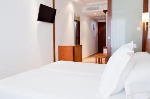 Cama o camas de una habitación en Hotel Jeni & Restaurant