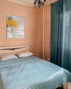 A bed or beds in a room at Boyarskaya Usadba