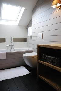 Ванная комната в B&B Villa des Roses
