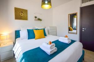 A bed or beds in a room at Blue Lotus Villa
