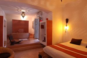 A bed or beds in a room at Riad O2