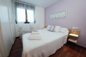 A bed or beds in a room at Little Home Girona