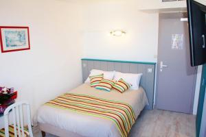Un ou plusieurs lits dans un hébergement de l'établissement Hotel Restaurant La Chaudrée