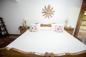 A bed or beds in a room at Atelier Molinaro Boutique Hotel