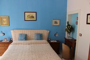 Letto o letti in una camera di L'Isola Di Ortigia