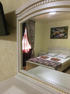 A bed or beds in a room at Отель Вачиан