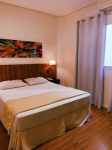 Cama ou camas em um quarto em Hotel Amália