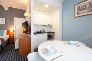 A kitchen or kitchenette at Leopold Hotel Ostend