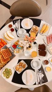 Opções de café da manhã disponíveis para hóspedes em Hotel Amália