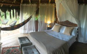 A bed or beds in a room at Jungle Lodge