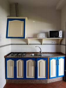 A kitchen or kitchenette at Apartamentos Los Mellizos