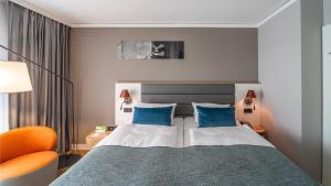 Ein Bett oder Betten in einem Zimmer der Unterkunft Holiday Inn Berlin Airport - Conference Centre, an IHG Hotel