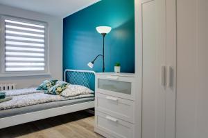 Łóżko lub łóżka w pokoju w obiekcie May Land Apartment