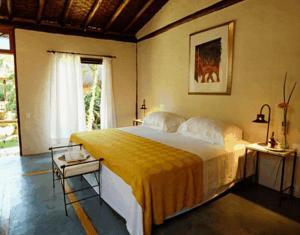 A bed or beds in a room at Pousada Refugio das Pedras