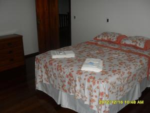 A bed or beds in a room at Casa Portuguesa 27